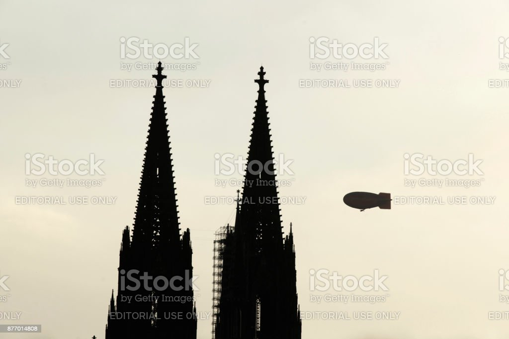 Airship crossing Cologne Cathedral stock photo
