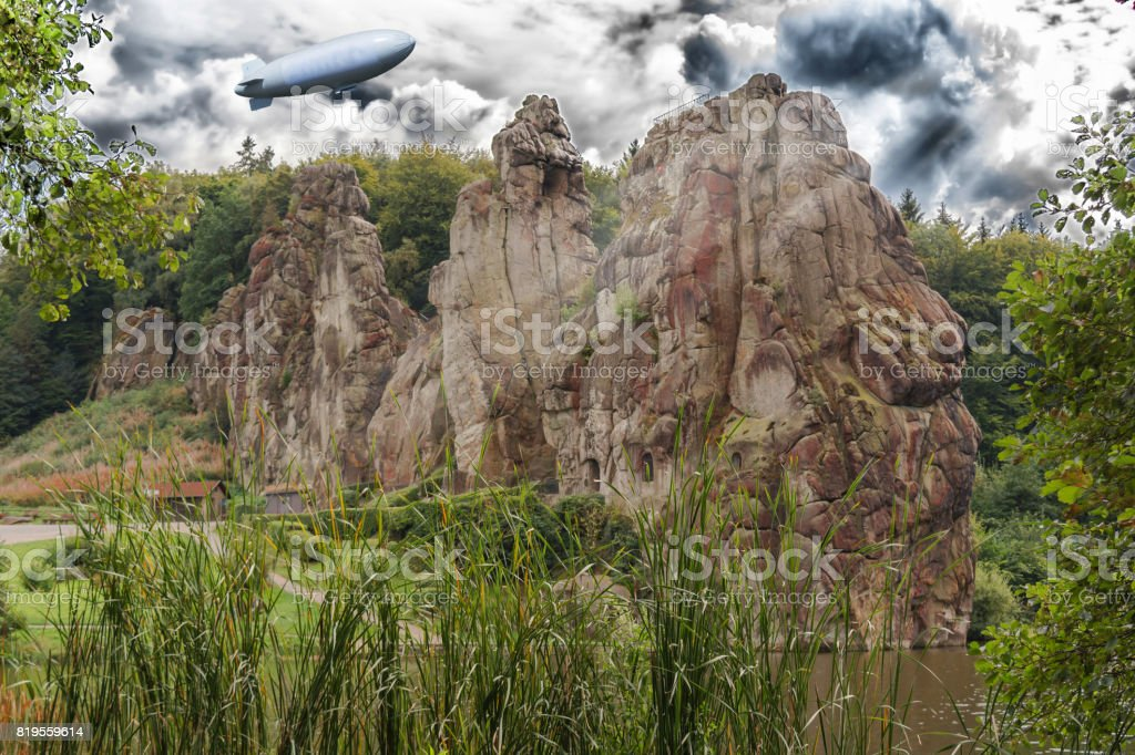 Airship, zeppelin flying over the Externsteine stock photo