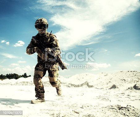 istock Airsoft game player running with weapon replica 1070971370