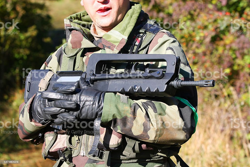 Airsoft game...Soldier with his weapon,assault rifle royalty-free stock photo