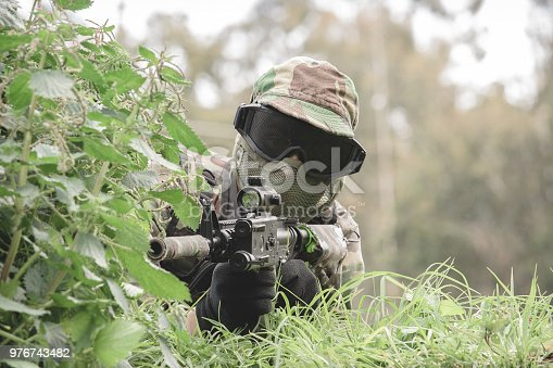 istock Airsoft soldier in the woods 976743482
