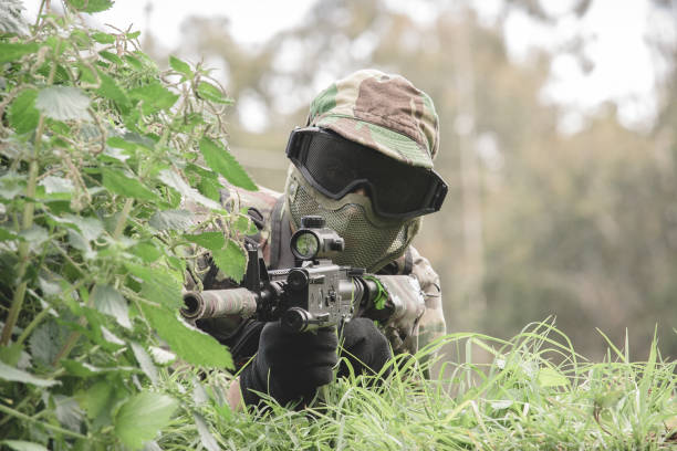 Airsoft soldier in the woods stock photo