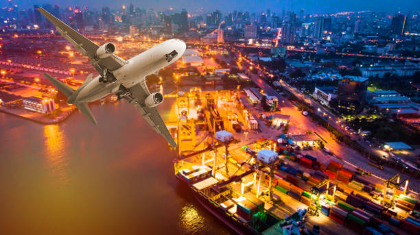 airspace of air transport and shipping. container ships and aircraft in the export and import business and transportation. delivery to international port. international trade concepts - drone shipyard night imagens e fotografias de stock
