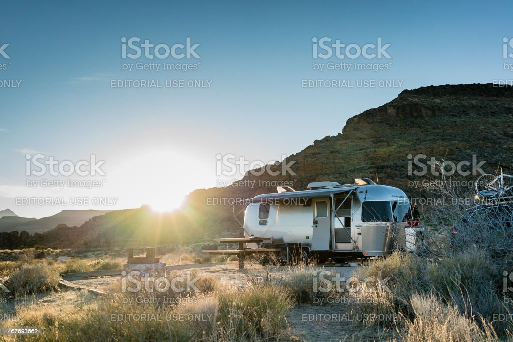 Airstream Trailer in Mojave Desert at Sunset stock photo