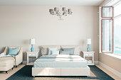 Modern bedroom interior with ocean view.