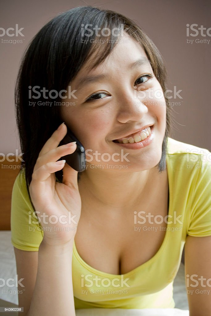 Aisan girl making a phone call royalty-free stock photo