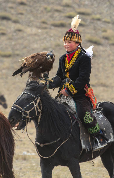Aisholpan, the eagle huntress, in a landscape of Mongolia stock photo