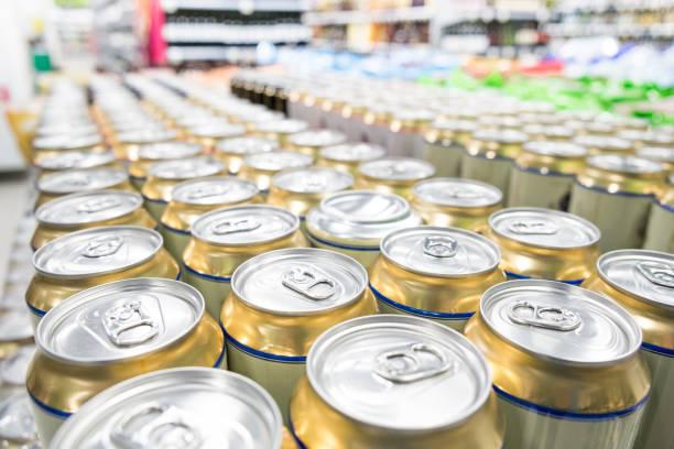 aisles of shelves in supermarket - prodotti supermercato foto e immagini stock