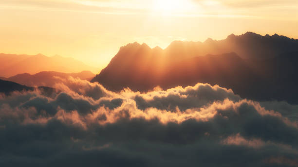 Aitzgorri mountain silhouette with sea of clouds and sun rays stock photo
