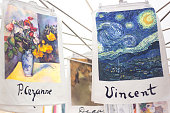 Aix-en-Provence, France: A retail display of Cezanne and Van Gogh dish towels for sale at the outdoor market on Cours Mirabeau in Aix-en-Provence. Both artists lived in Provence.