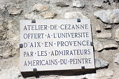 Aix-en-Provence, France: A stone memorial plaque outside the entrance to Cezanne's historic studio/atelier in Aix-en-Provence announcing that America admirers of Cezanne donated his studio to the University of Aix-en-Provence (now the University of Provence Aix-Marseille).