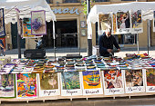Aix-en-Provence, France: A retail display of dish towels featuring French artists for sale at the outdoor market on Cours Mirabeau in Aix-en-Provence.