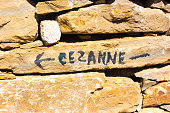 Aix-en-Provence, France: A handprinted sign pointing to Terrain des Peintres (Painters' Park), a public park where Paul Cézanne came to paint Mont Sainte-Victoire.