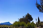 Aix-en-Provence, France: Terrain des Peintres (Painters' Park), with Mont Sainte-Victoire in the distance. Now a public park, this is where Paul Cézanne came to paint Mont Sainte-Victoire. Copy space in the sky.