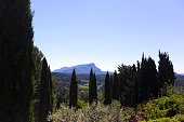 Aix-en-Provence, France: Terrain des Peintres (Painters' Park), with Mont Sainte-Victoire in the distance. Now a public park, this is where Paul Cézanne came to paint Mont Sainte-Victoire. Copy space in the sky.