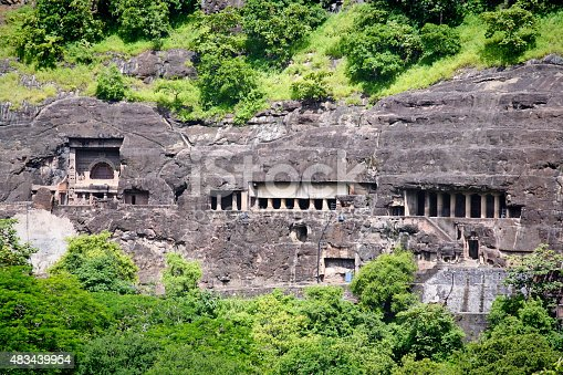 A series of ancient historic Buddhist Cave Temples. Caved into the side of the mountain in Arrangabad, in the Indian state of Maharashtra. India. A UNESCO World Heritage Site, and one of the major tourist destination in the region. Photographed on location outside the cave site in Ajanta in horizontal format.