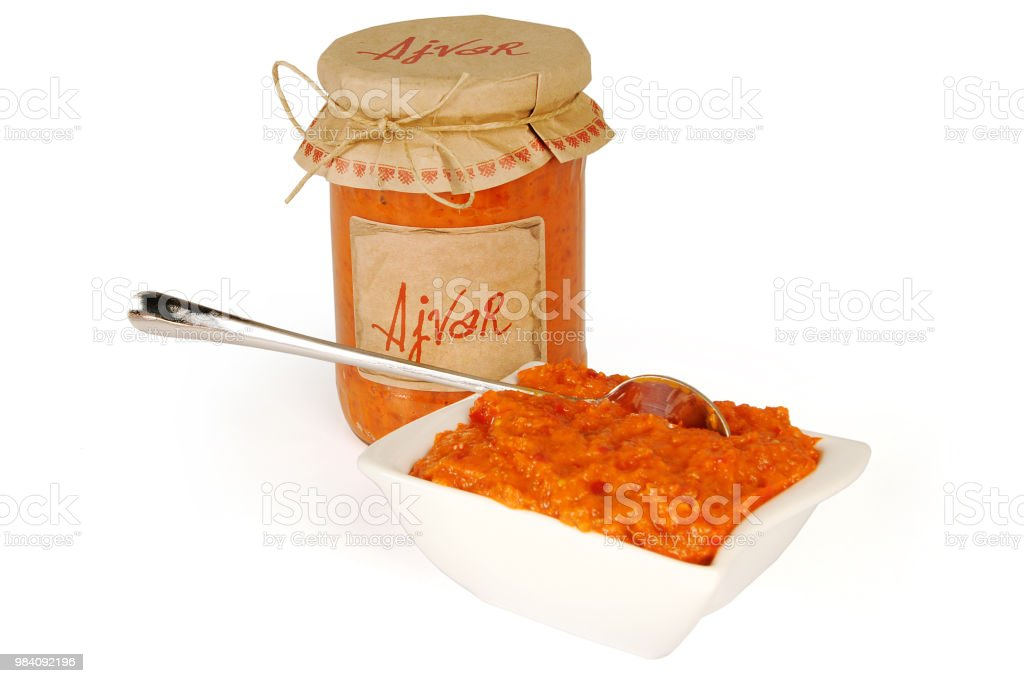 Ajvar, a delicious roasted red pepper and eggplant dish. Serbian and Macedonian traditional dish. Sauce in white bowl. stock photo