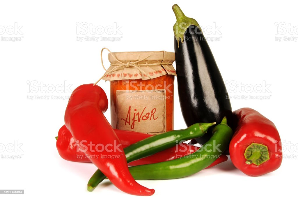 Ajvar - delicious dish of red and green peppers, onions, garlic, eggplant. Ajvar in jar. stock photo