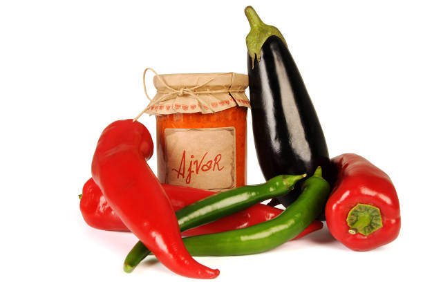 Ajvar - delicious dish of red and green peppers, onions, garlic, eggplant. Ajvar in jar. – zdjęcie
