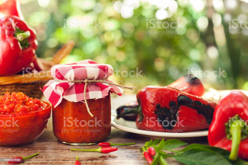 Ajvar in jar and glass bowl stock photo