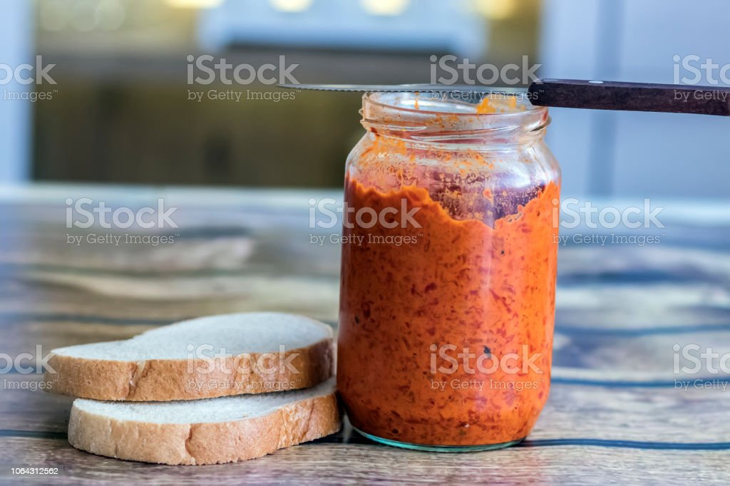 Ajvar Jar on the Table stock photo
