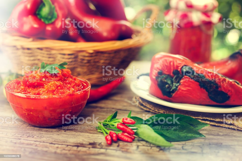 Ajvar,chili peppers and paprika on plate stock photo