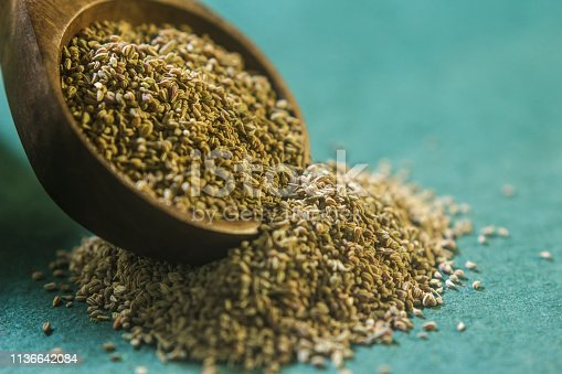 Ajwain seeds in a wooden spoon