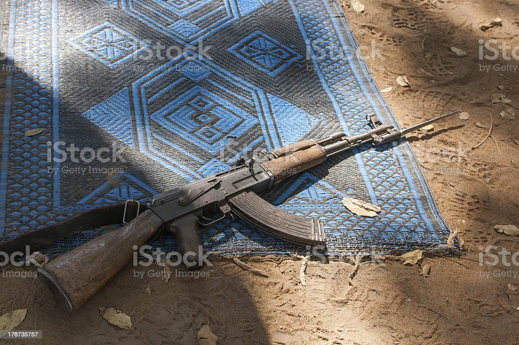 Ak47 gun on prayer mat stock photo