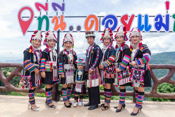 Akha hill tribe with traditional clothes on Akha Swing Festival. The annual Akha Swing Festival is pretty much about women and fertility. - foto stock