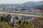 Akita,Tohoku,Japan:Panoramic view of Kakunodate town and the Hinokinaigawa River during cherry blossom festival