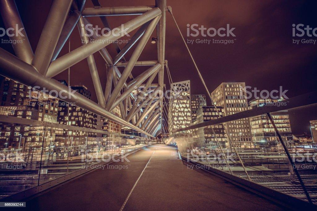 Akrobaten Pedestrian Bridge in Oslo at Night, Norway stock photo