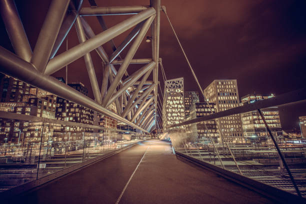 Akrobaten Pedestrian Bridge in Oslo at Night, Norway Akrobaten pedestrian bridge in Oslo at Night, Norway oslo stock pictures, royalty-free photos & images