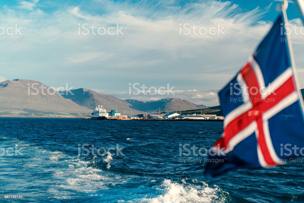 Akureyri seashore with Iceland flag stock photo