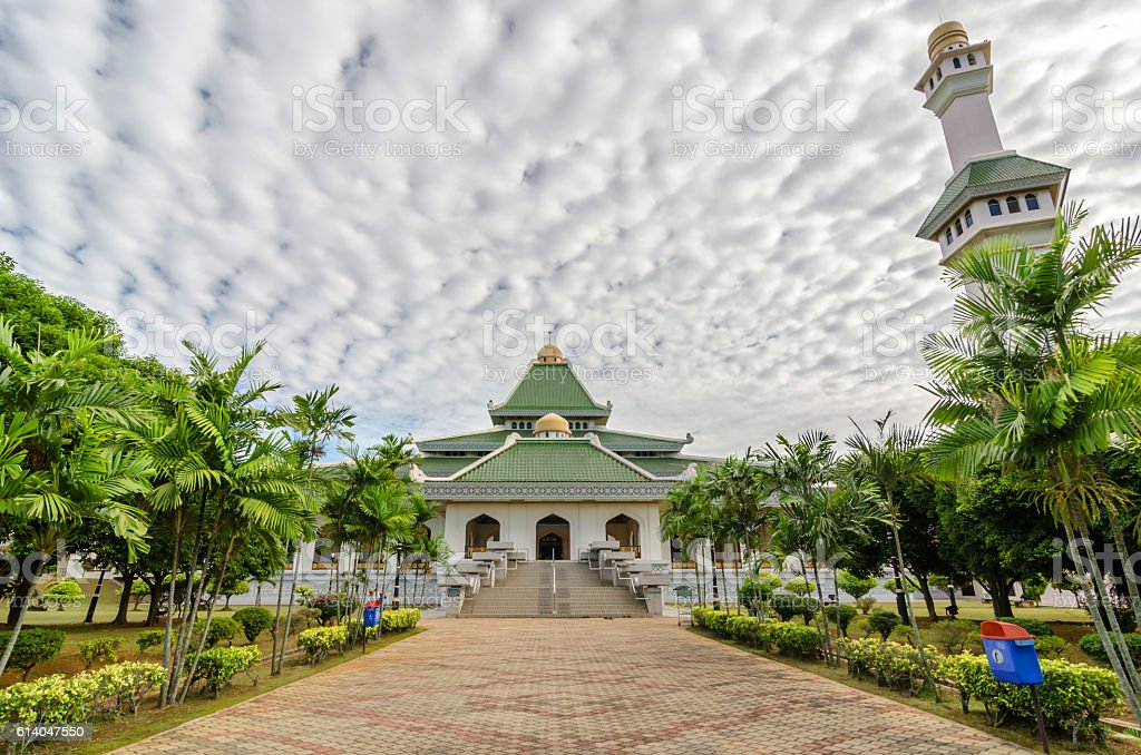 Al Azim mosque with stunning blue sky and cloud stock photo