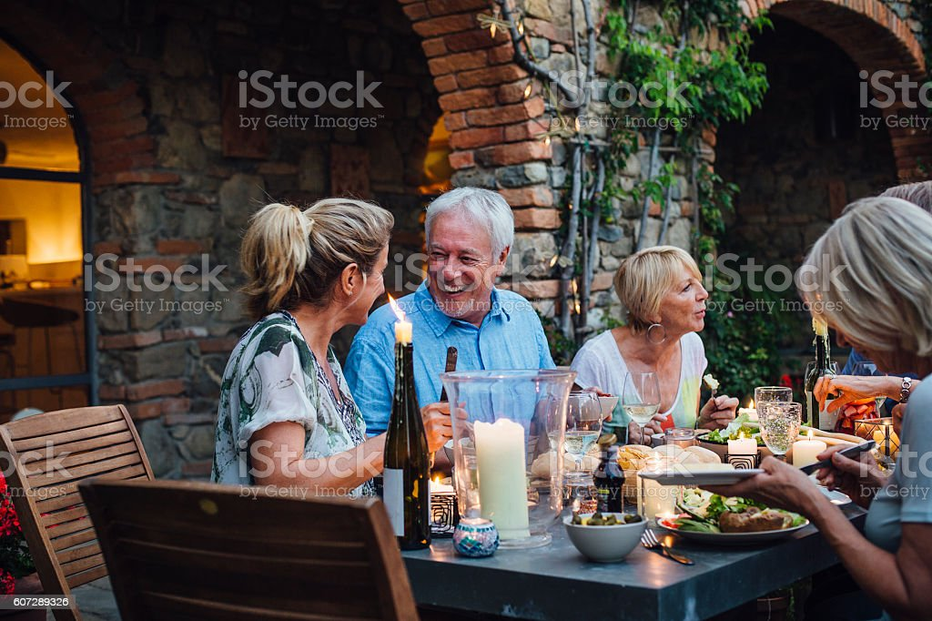 Al Fresco Dining with Friends stock photo