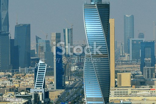 Riyadh, Saudi Arabia: the twisted Al Majdoul tower, NKY tower and Nakheel Tower to its left - view north over the business district along King Fahd Road - skyline with skyscrapers, King Abdullah Financial District in the background with the Capital Market Authority Tower