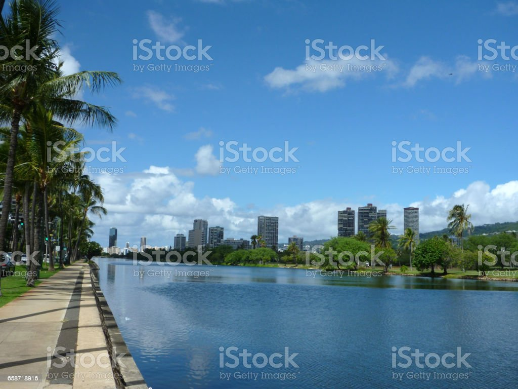 Ala Wai Canal, hotels, Condos, Golf Course and Coconut trees on a nice day in Waikiki stock photo