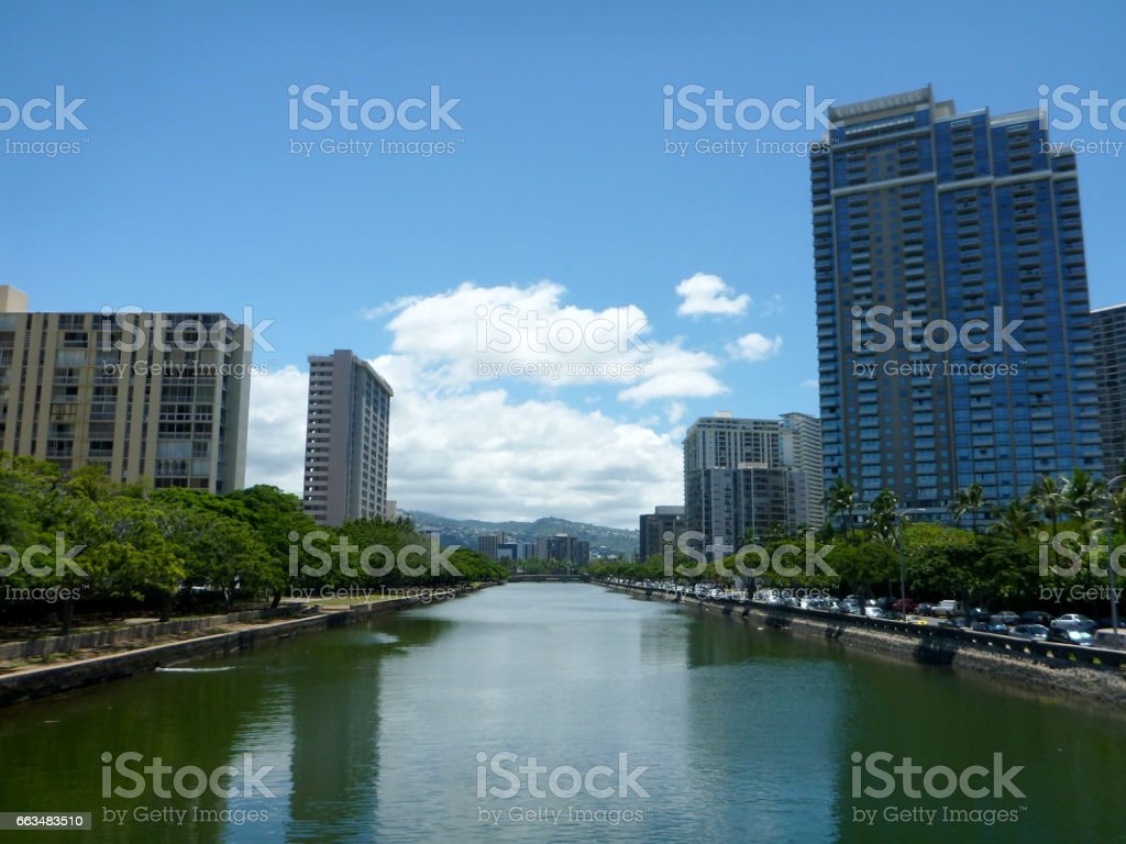 Ala Wai Canal in Waikiki surrounded by tall buildings and trees stock photo