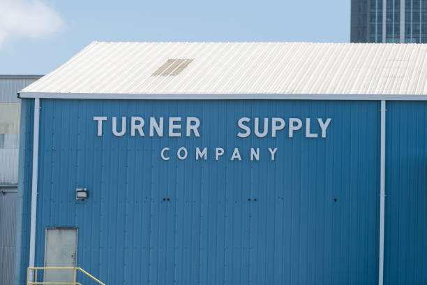 alabama city sky with modern business buildings and sign for turner supply company - mro stock photos and pictures
