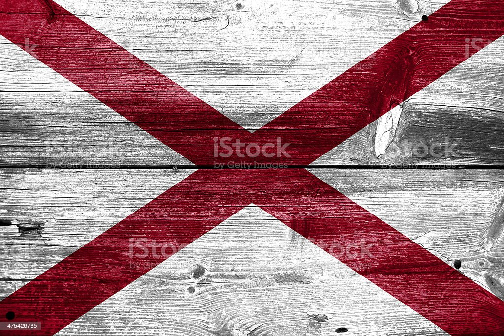 Alabama State Flag painted on old wood plank texture royalty-free stock photo