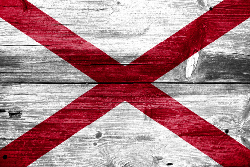 istock Alabama State Flag painted on old wood plank texture 475426735