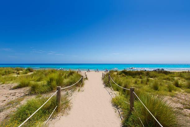 Alaior Cala Son Bou in Menorca turquoise beach at Balearic stock photo