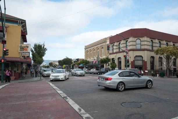 Alameda California Alameda, California, United States - August 13, 2018:  Retail stores and traffic in the downtown area on Alameda Island, Alameda, California, August 13, 2018 alameda california stock pictures, royalty-free photos & images