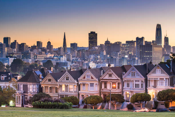 Alamo square and Painted Ladies with San Francisco skyline San Francisco - California, Alamo Square, Urban Skyline, City, Famous Place modern period stock pictures, royalty-free photos & images