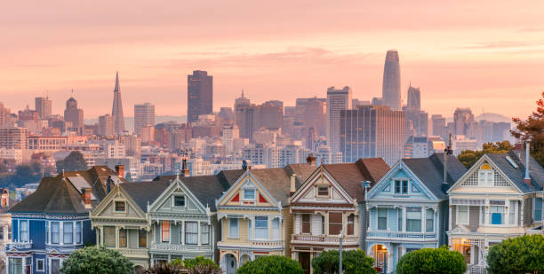 Alamo square and Painted Ladies with San Francisco skyline San Francisco - California, Urban Skyline, Street, City, USA. Salesforce Tower on the background. san francisco california stock pictures, royalty-free photos & images