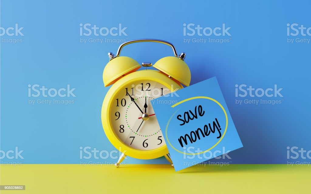 Alarm Clock And A Blue Post It Not Over Blue Background stock photo