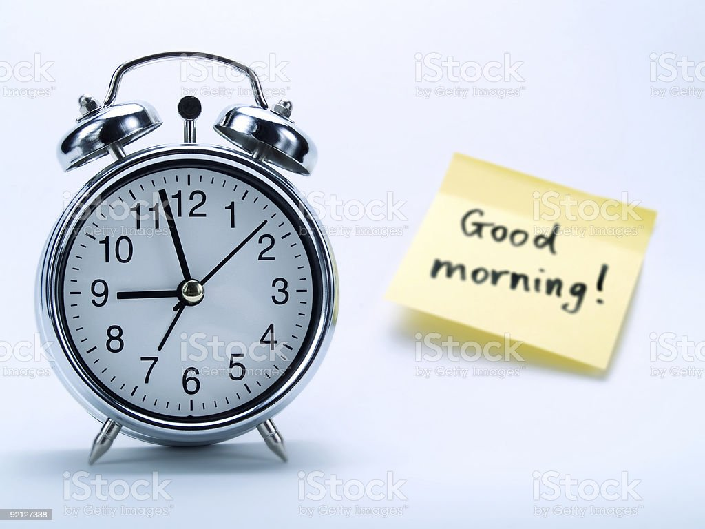 Alarm clock and a yellow note royalty-free stock photo