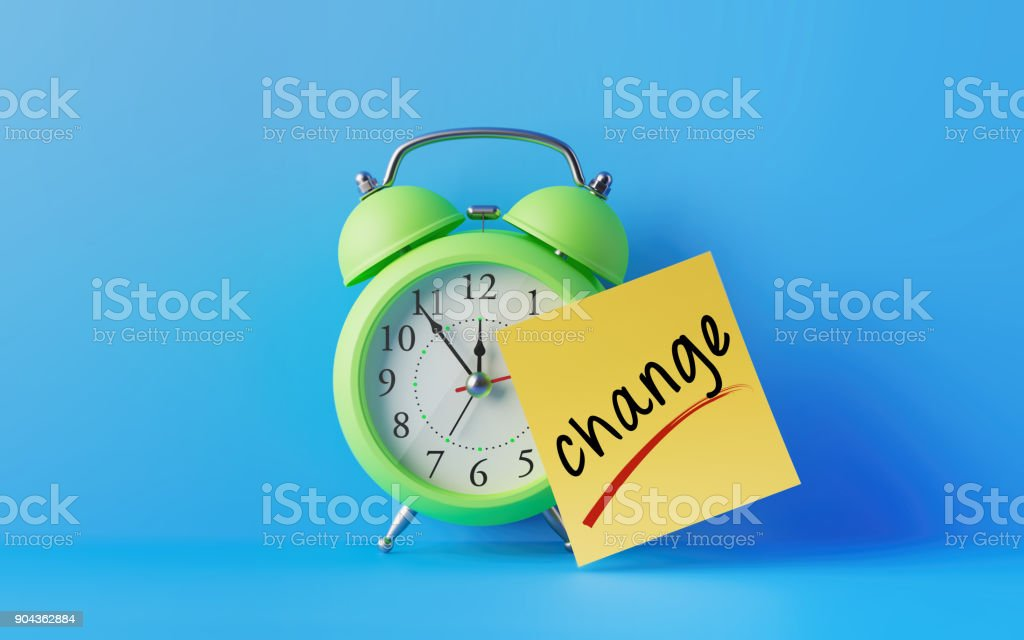 Alarm Clock And A Yellow Post It Not Over Blue Background stock photo