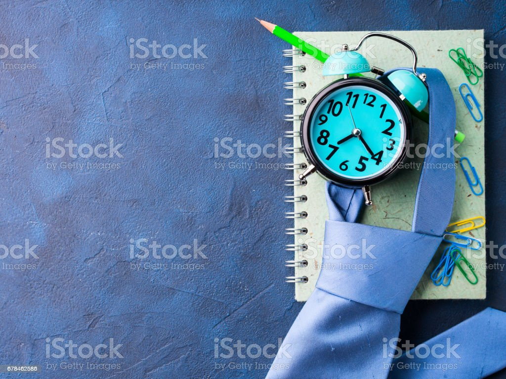 Alarm clock and businessman's accessories royalty-free stock photo