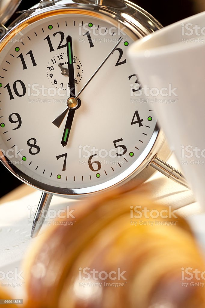 Alarm Clock and Continental Breakfast of Croissant & Coffee royalty-free stock photo